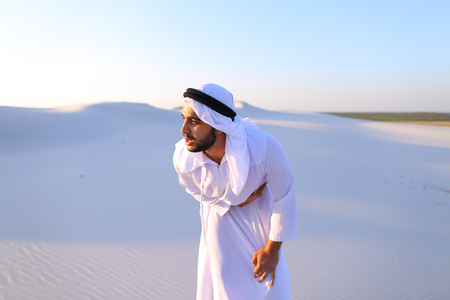 Concept of Arab and Muslim men, United Arab Emirates and beautiful landscapes, advertisement of pharmaceuticals and medicines, deteriorated state of health and prevention of treatment of diseases, national clothing of Emirates.