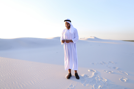 Stately young male Arab man in good mood