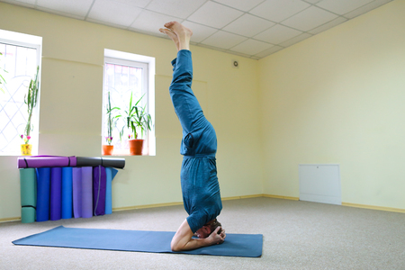 Young Man Sports Athlete Doing Yoga Sitting On Floor In Room