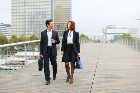 economists walk during lunch break, married American middle-aged couple going to have snack.