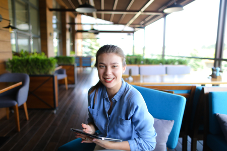 Young female person dressed in casual resting at catering establishment Stok Fotoğraf