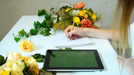 Hands of young woman who works with flowers.