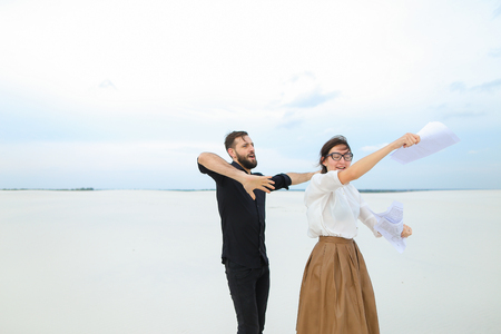 future lawyers male and female come to seaside to have rest after passing exams, girl with ponytail in glasses tell good news friend bearded man with short fair hair. Banco de Imagens
