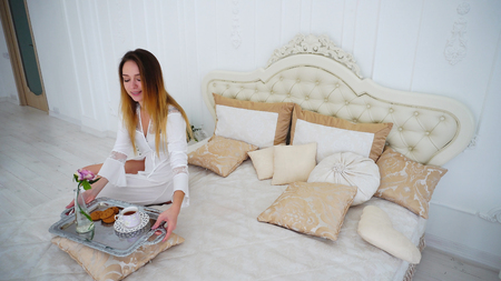 Beautiful Young Woman Brewed Refreshing Drink on bed