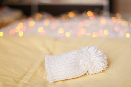 White cap for newborn baby on blanket. Concept of warm things for babies. 스톡 콘텐츠