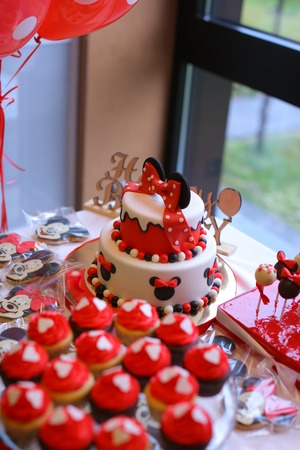 Tasty Mickey Mouse cakes for birthday. Concept of sweets for party.
