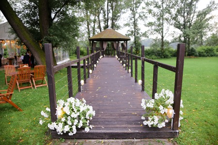 Alcove in garden and decorations for wedding. Concept of flowers and nature.