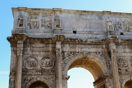 Closeup arch of Constantine in Rome, Italy. Concept of ancient landmarks and last minute cheap tours to Europe.