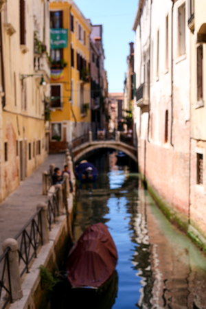 Venetsian sunny street, water and cityscape, Italy. Concept of last minute tours to Venice, amazing sumer vacations and trip to Europe landmarks. Stock Photo