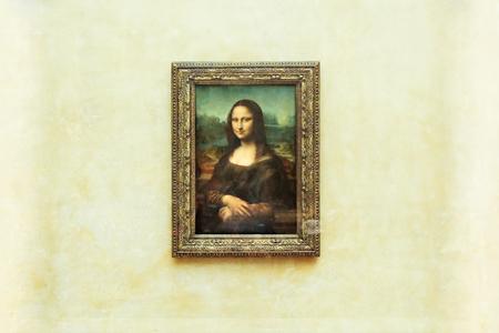 PARIS, FRANCE - MAY 01, 2018: Mona Lisa, La Joconde Leonardo da Vinci in white wall background in Louvre. Concept of painting of Rebirth and portraits. Editorial