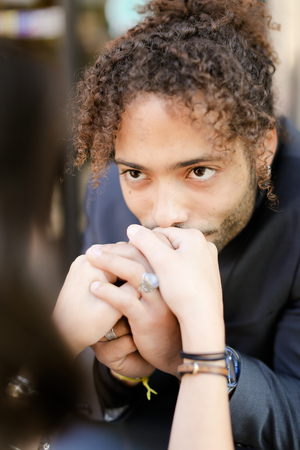 Focus on afro american boy kissing female hands. Concept of love and dating with black man.