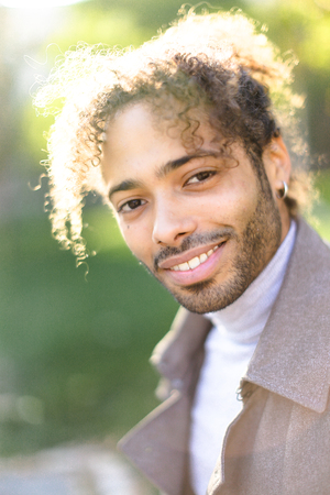 Portrait of afro american smiling boy with curly hair. Concept of male person.