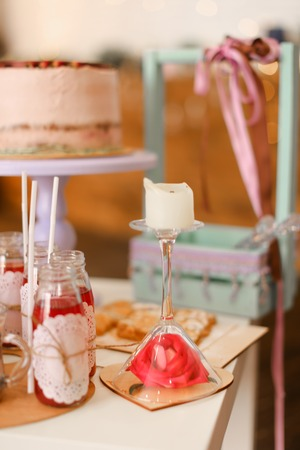Tasty big birthday cake and yummy drinks on table. Concept of delicious sweets and celebrating party.