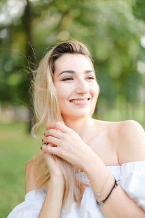 Portrait of young happy girl, green background. Concept of beauty and everyday makeup. Фото со стока