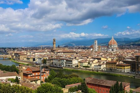 Amazing Florense cityscape with clouds in background, Italy. Concept of pictures for postcards of european landscapes and cheap tours to Europe.