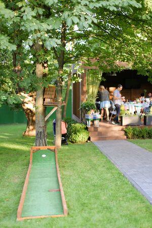 Children playground for golf near cafe.