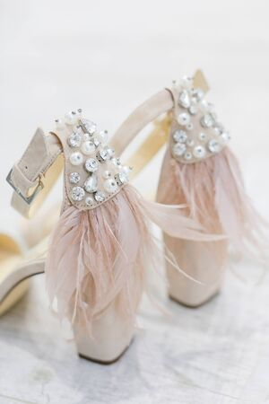 Closeup bridal shoes on white background. Concept of wedding elements.