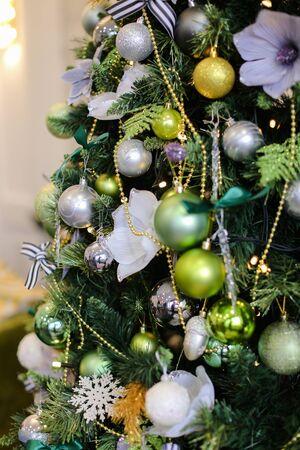 Closeup decorated Cristmas tree. Concept of winter holidays background photo Reklamní fotografie