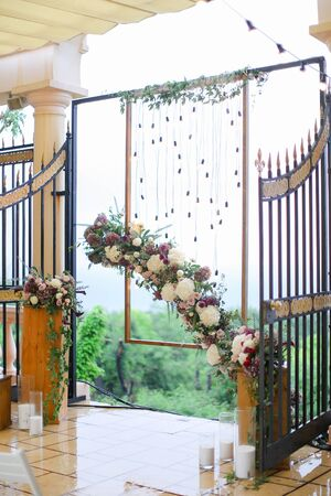 Flower arch for wedding at restaurant. Concept of floristic decorations.