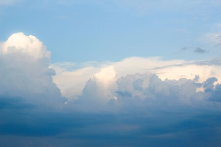 Amazing clouds on blue sky. Concept of background photo and cloudscape.