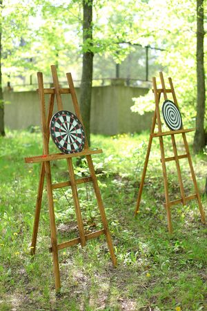 Darts targets on easels in garden. Concept of active games and rest.