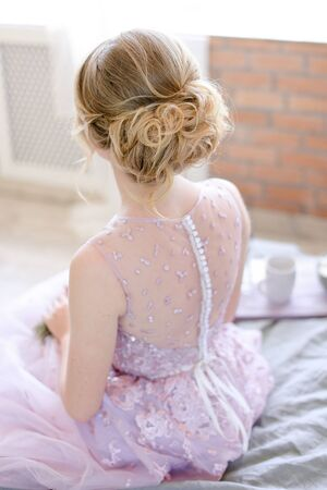 Back view of blonde bridal hairstyle. Concept of wedding day and fiancee. Stock Photo