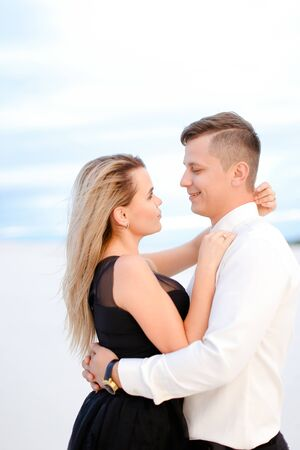 Portrait of girl hugging man in white background. Concept of love and relationship.