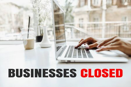 Female hands texting on laptop keyboard at home because of quarantine. Concept of closed business. Standard-Bild