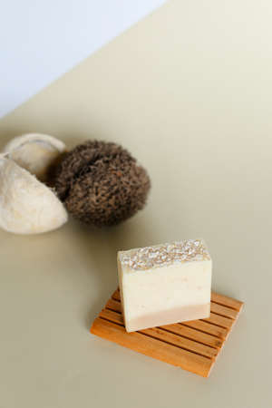 Handmade white soap with olive oil on wooden stand. Concept of organic cosmetics online shop