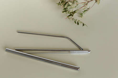 three steel silver reusable straws isolated on white background. Replacing plastic, alternative. Concept zero waste.