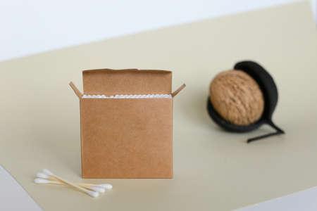 Bamboo cotton swabs on orange table. Zero waste, plastic free lifestyle concept
