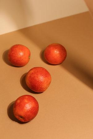 Juicy dark tangerines on light background. Tasty fruits. Focus on front tangerine Selective focus