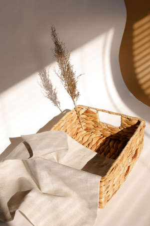 Wicker basket with beige napkin, closeup. beautiful photo for decoration