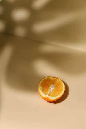 Slice of fresh orange isolated on beige background
