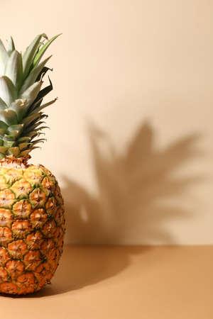 Pineapple isolated on neutral beige background Standard-Bild