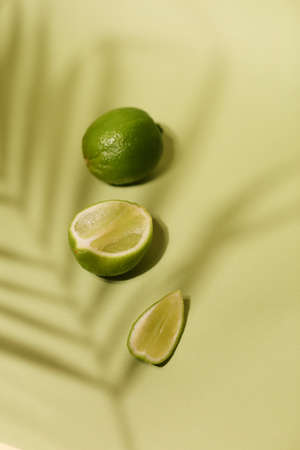 Fresh lime and slice, Isolated on light green background