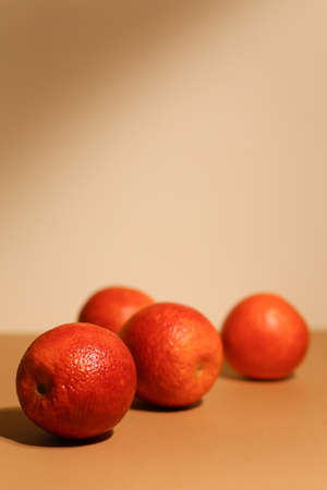 Juicy dark tangerines on light background. Tasty fruits. Focus on front tangerine.