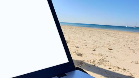 A black Laptop With White Screen and Beach Background