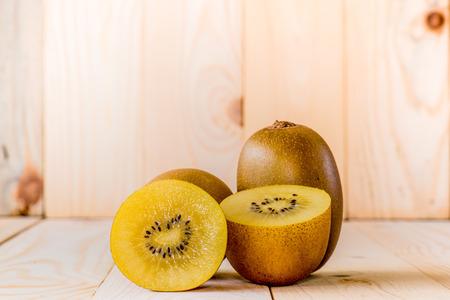 kiwi: Gold kiwi fruit on a wooden background