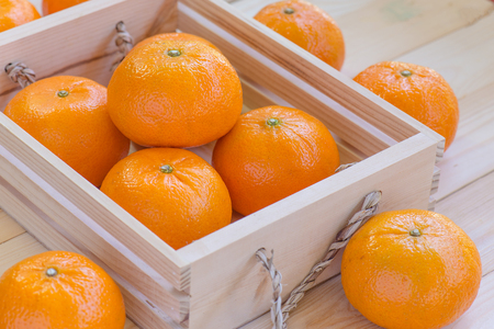 wooden crate: orange fruits  in a wooden crate
