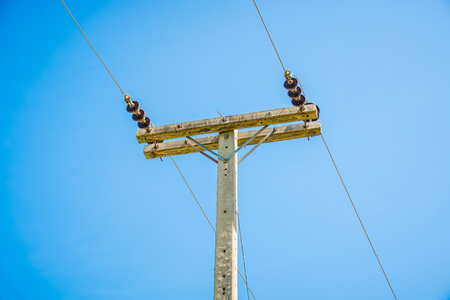 electric current: electricity post on blue sky background Stock Photo
