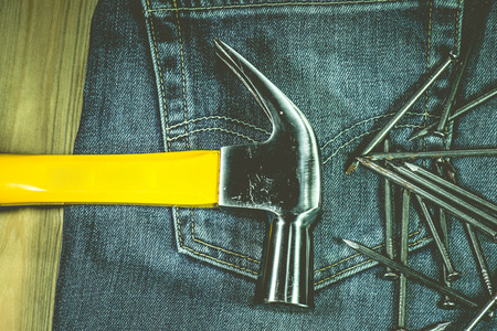 garment label: A hammer and nails on jeans Stock Photo