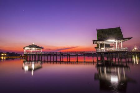Wooden bridge in the sunset