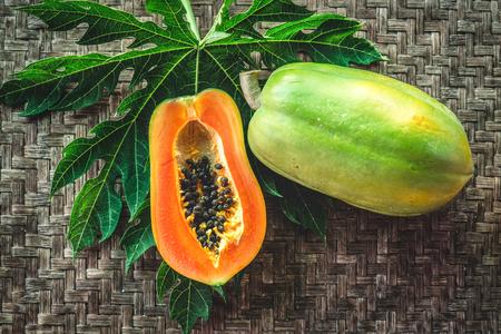 Papaya fruit on wooden background Stock Photo