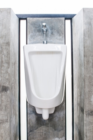 Urinals in male toilets made   of white porcelain  Stock Photo - 16255160