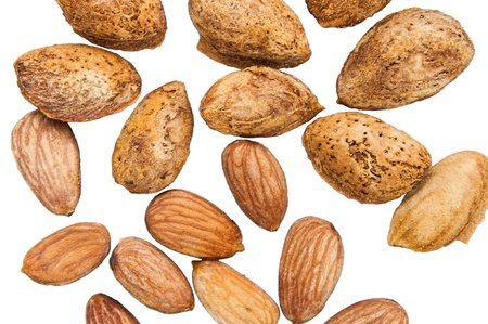 casings: Almond seeds with shell casings and not peel on a white background  Stock Photo