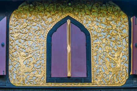 Pattern with carved windows of old houses in Thailand  photo