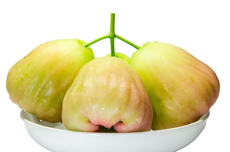 The bunch of green rose apple fruit on white dish  photo