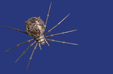 arachnoid: Puppets spider iron on blue background  Stock Photo