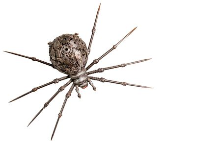 arachnoid: Puppets spider iron on a white background  Stock Photo